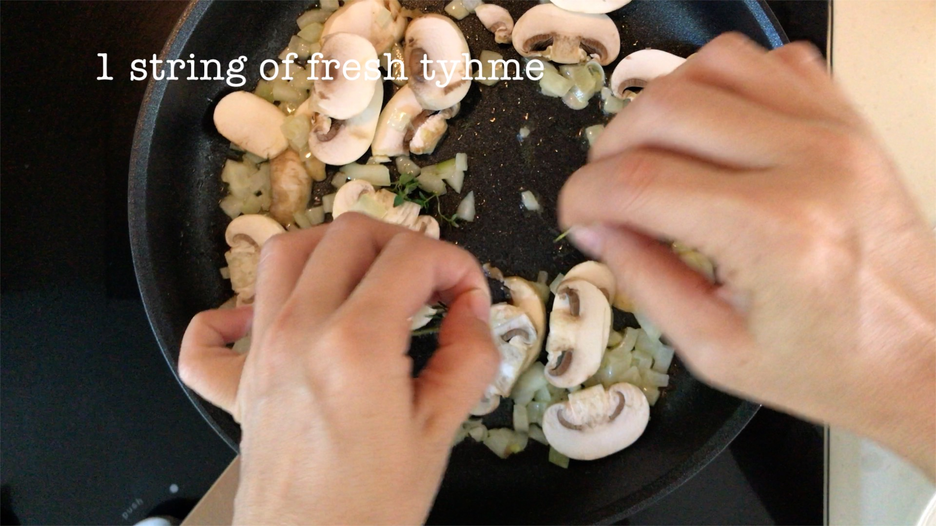 picking a string of fresh thyme and add in the sauteed mushroom and onion