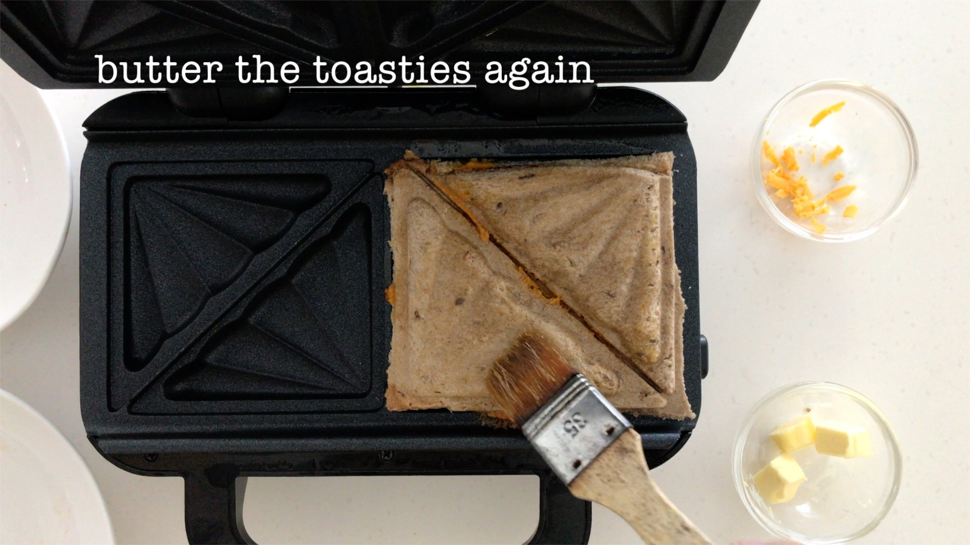 Brush melted butter all over the toasties