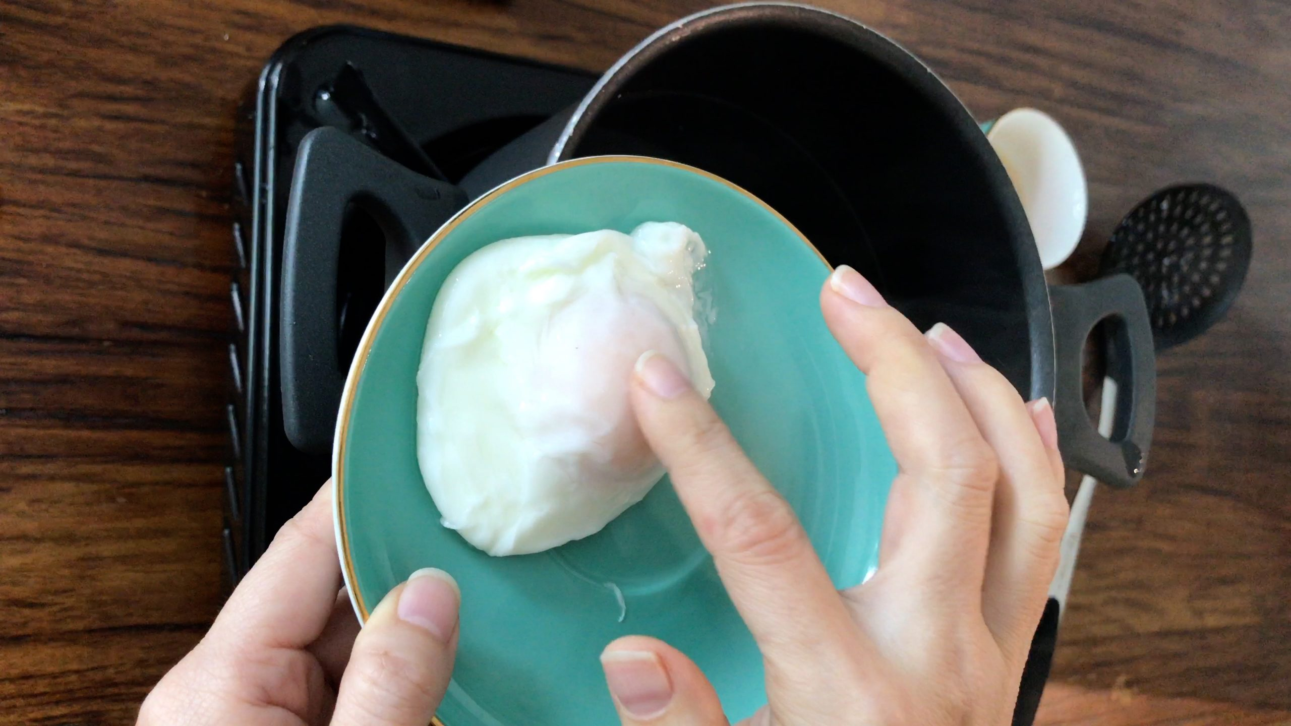 Use a finger poking the poached egg